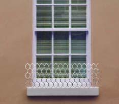 Screen to block pigeons on windows