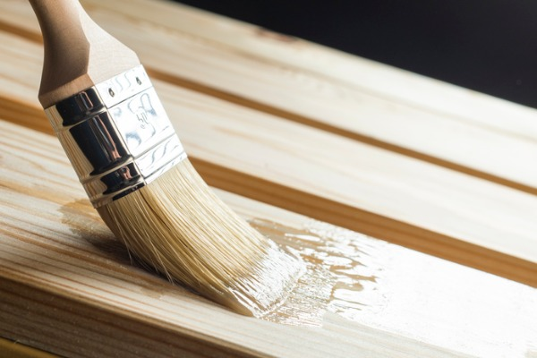 application of sealant on a wooden surface