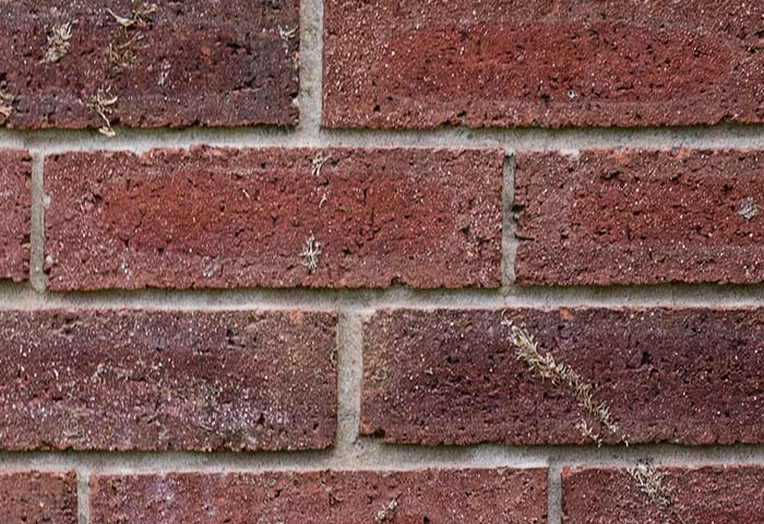caulking smeared on brick