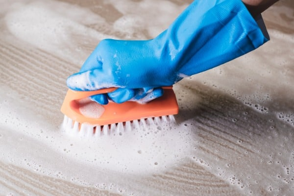 cleaning concrete with brush