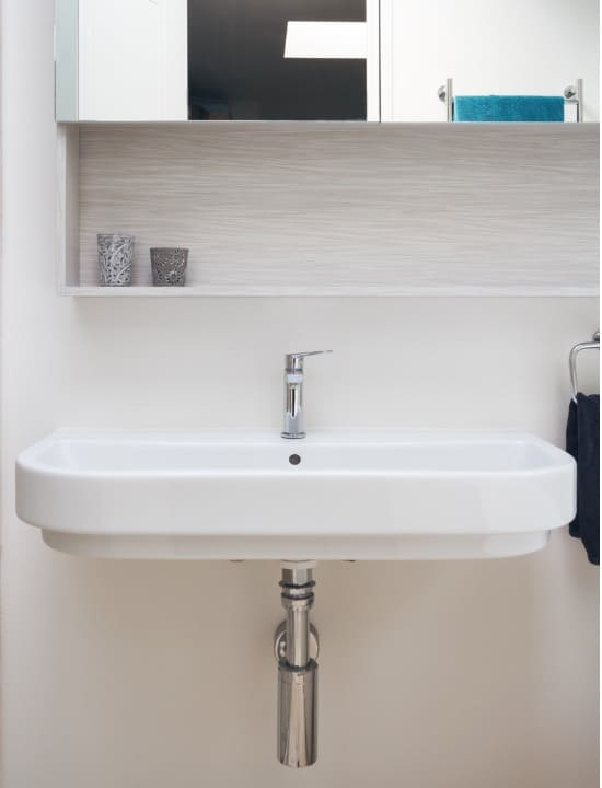 close up mounted sink on wall