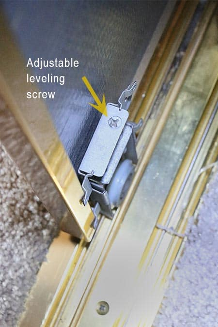 Mounting screw to adjust roller and door height