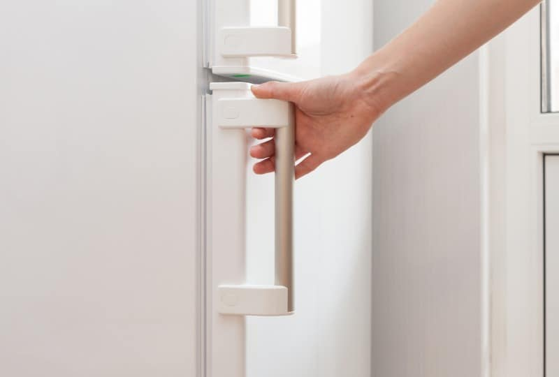 hand pushing door shut