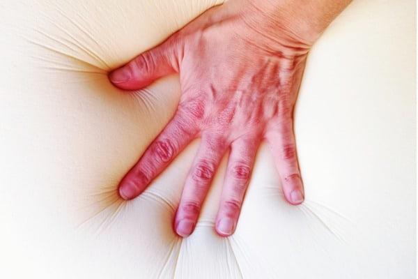 hand-sinks-into-a-soft-memory-foam-