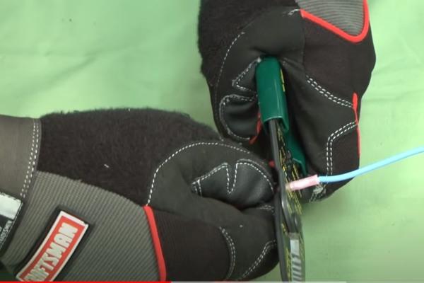 hand with glove stripping wire