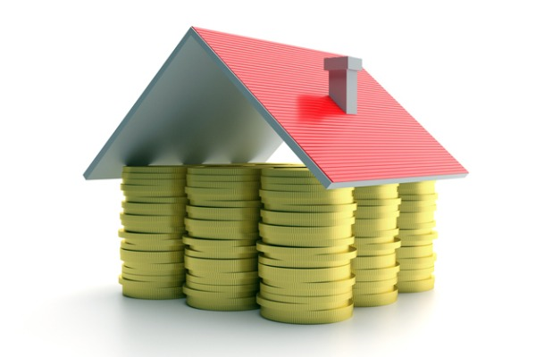 house roof on gold coins stacked