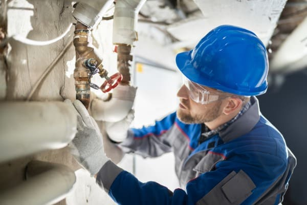 male worker inspecting valve