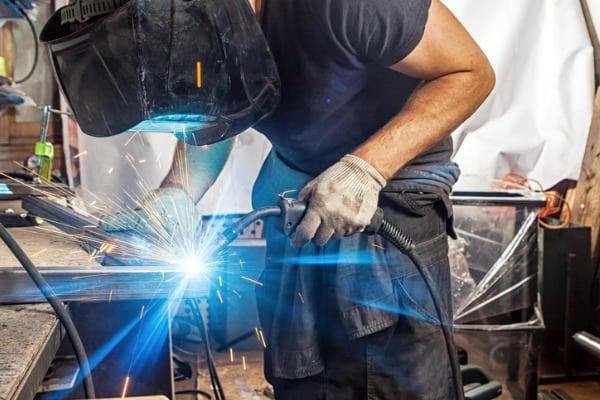 man-welds-with-a-welding-machine