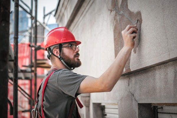 man-worker-standing-on-concrete