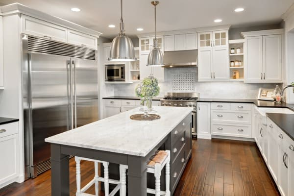 kitchen with white quartz countertop and backsplash