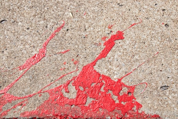 red-paint-splattered-concrete
