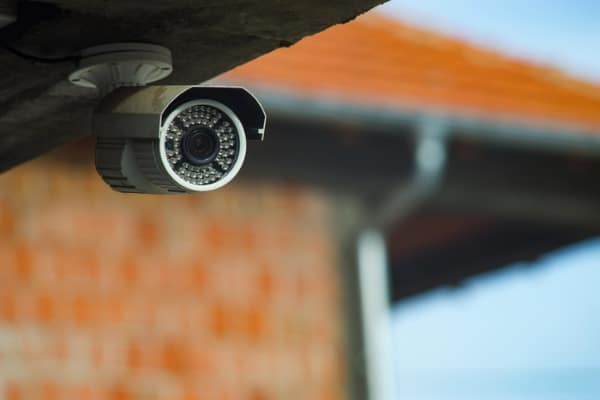 surveillance security camera under the concrete wall of the building