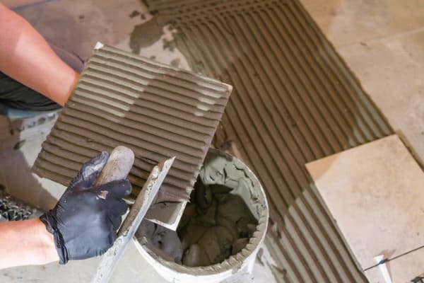 thinset mortar on a concrete tile