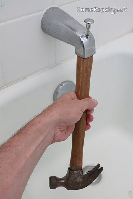 Use a hammer to rotate tub spout off