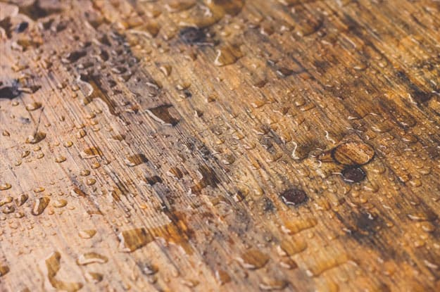 Which is waterproof, laminate or hardwood?