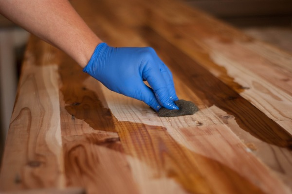 woodwork oil being applied on wood