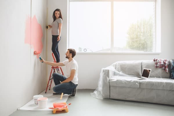 young couple doing apartment repair together